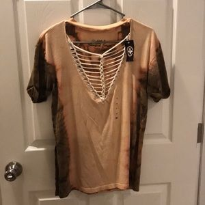 Xs affliction. Fits more like a medium. NWT.